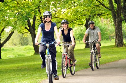 three people cycling in park